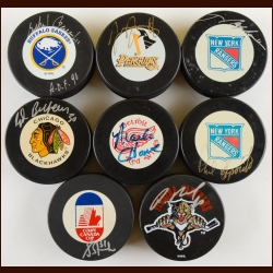 Lot of (8) Hall of Fame Autographed Pucks