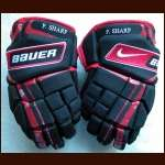 2009-10 Patrick Sharp Blackhawks Black & Red Bauer/Nike Game Worn Gloves - Stanley Cup Season - Autographed - Team Letter
