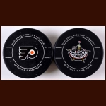 2011-12 Patrick Kane Lot of 2 Goal Pucks - 113th Career Goal Puck and 2012 All Star Game Goal Puck – Team Letter - NHL Letter