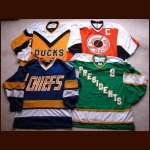 "Group of 4 ""Slap Shot"" Autographed Replica Jerseys"