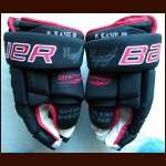2009-10 Patrick Kane Blackhawks Black & Red Bauer Game Worn Gloves - Stanley Cup Season - Autographed - Team Letter
