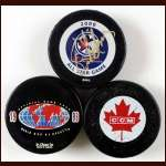 Lot of 3 Game Used Hockey Pucks - 2000 NHL All Star, 1996 World Cup of Hockey and 1981 Canada Cup
