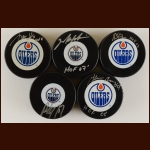 Edmonton Oilers Hall of Fame Autographed Puck Group of 5 – Mark Messier, Paul Coffey, Jari Kurri, Glen Anderson & Grant Fuhr