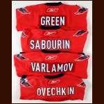 Lot of (4) Lightweight Washington Capitals Replica Jerseys - Alex Ovechkin, Mike Green, Ken Sabourin and Semyon Varlamov