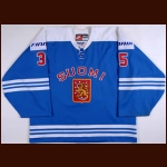 "2008 Petri Vehanen Team Finland World Championships Game Worn Jersey - ""100-year IIHF"" - ""1965"" - Photo Match - Team Finland Letter"