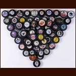 Misc. Autographed Puck Group of 63 - Many HOFers Including Bobby Orr